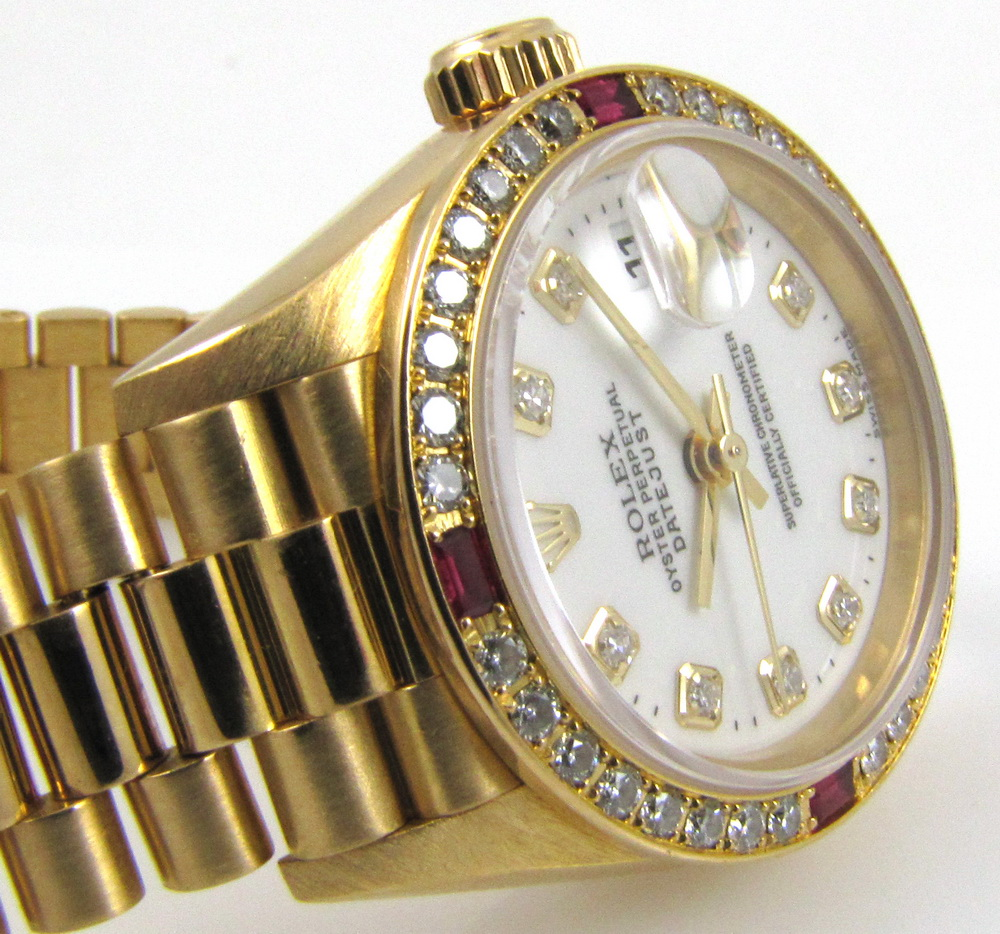 Rolex 69068 Ladies President with Serti Dial and W serial from 1995-1996.