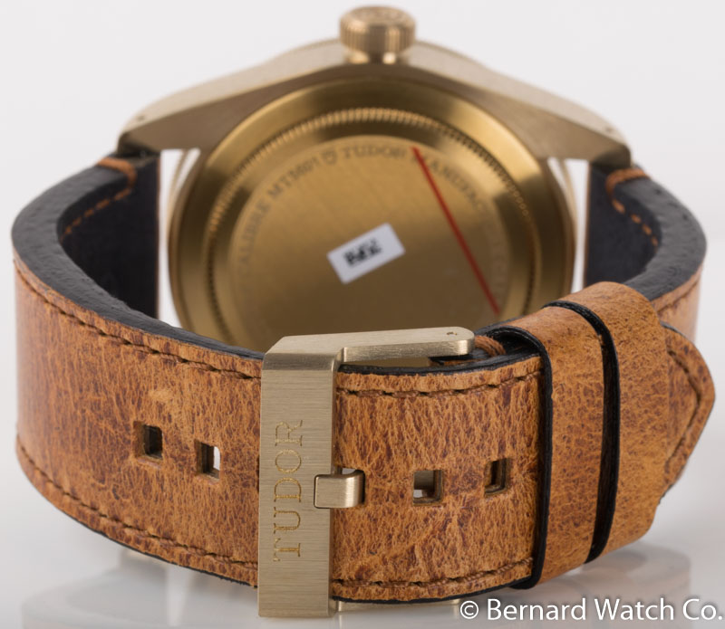 Rear shot of Heritage Black Bay Bronze with brown leather strap + beige nylon strap